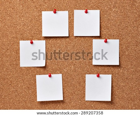 note papers on a cork board