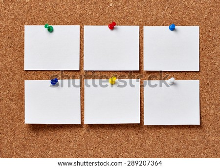 note papers on a cork board - stock photo