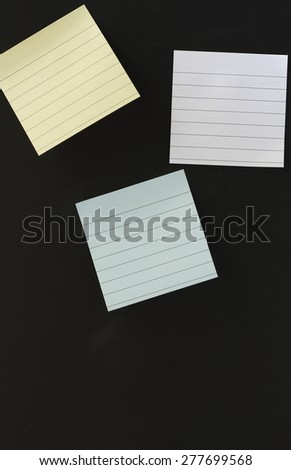 note papers or notepad paper posting on black background - stock photo