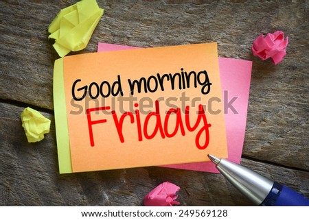 Note with Good morning Friday. Note with Good morning Friday on the wooden background with pen - stock photo