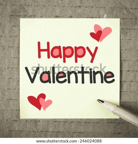 Note with Happy Valentine. Note with Happy Valentine text and pencil on grunge background - stock photo