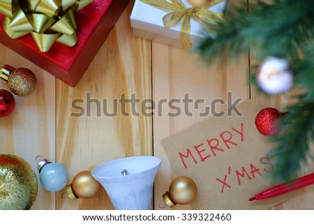 Note with the christmas theme on wooden background - stock photo
