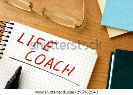 Note with words life coach  on a wooden background. - stock photo