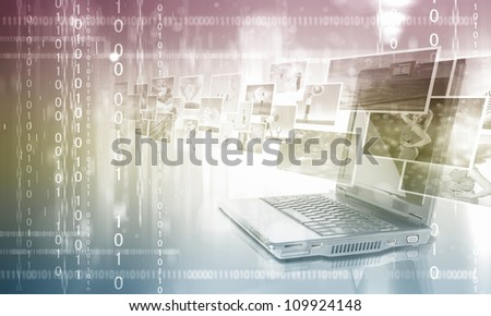 Notebook against colour background with various images - stock photo