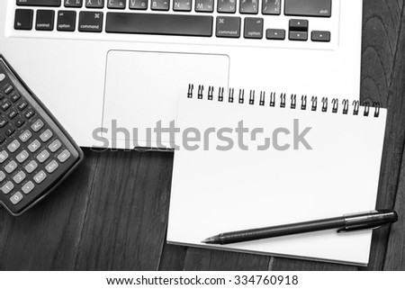 Notebook an address book with blank sheets and calculator on the laptop. Business a concept idea. - stock photo