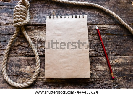 notebook and a loop for suicide - stock photo