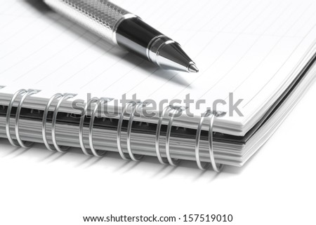 notebook and business pen in composition on white background