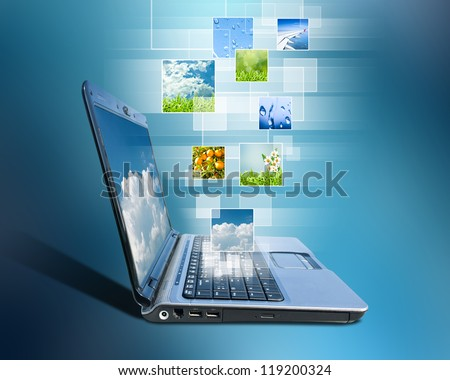 notebook and button a touch screen interface against blue background - stock photo