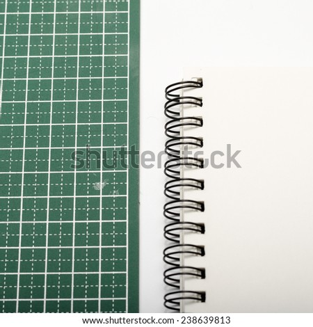 notebook and cutting mat on a white background