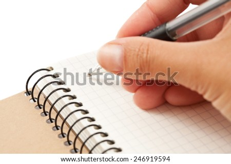 Notebook and hand with pen, isolated - stock photo