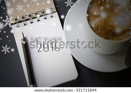 Notebook and hot coffee for Happy New Year 2016 - stock photo