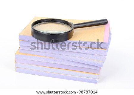 Notebook and magnifier - stock photo