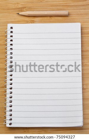Notebook and pen on a desk