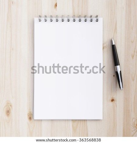 notebook  and pen on a wooden table - stock photo