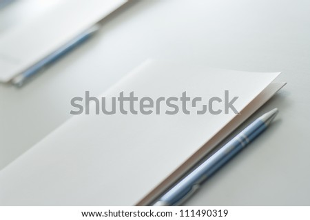 Notebook and pen on table.
