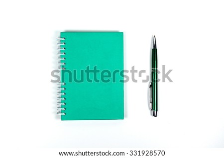 Notebook and pen on white background - stock photo