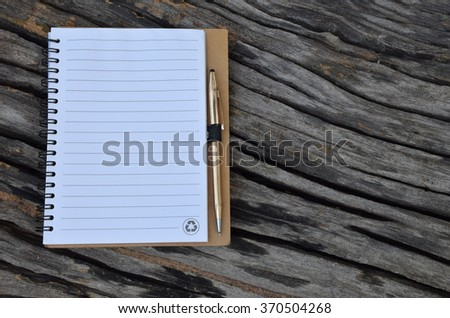 Notebook and pen with the old wood texture
