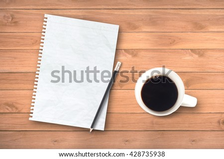 notebook and pencil on rustic table from above, cozy and sweet breakfast, good morning or have a nice day concept