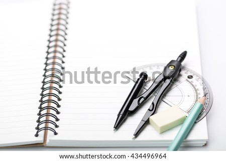 Notebook and pencil with stationary objects  on a white background - stock photo