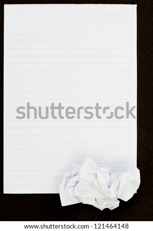Notebook black background open view and crumpled paper - stock photo