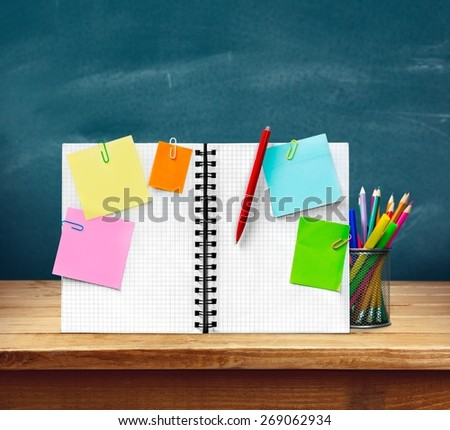 Notebook. Blank checked notebook with notice papers isolated on white background cutout - stock photo