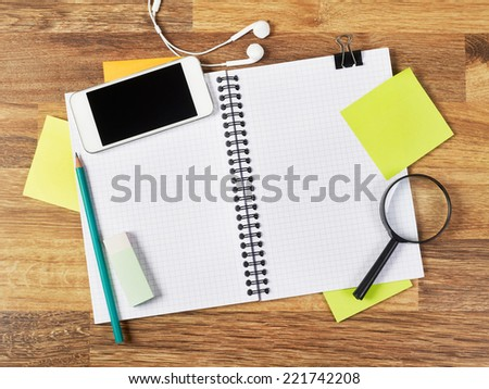 Notebook Blank notebook with supplies - stock photo