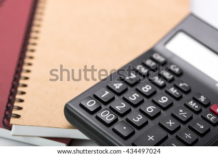 notebook , calculator and pencil on white background - stock photo