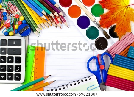 Notebook , colored pencils, back to school concept surface  with copy space over white background