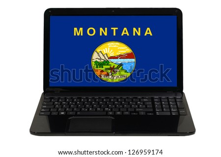 notebook computer with flag of us state of montana - stock photo