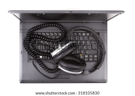 Notebook Computer with headphones over white background