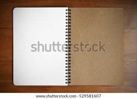 Notebook empty on wooden background