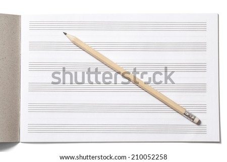 Notebook for musical notes and pencil on white