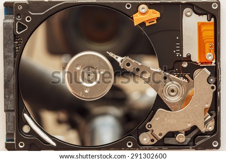 Notebook hard drives on the background. - stock photo