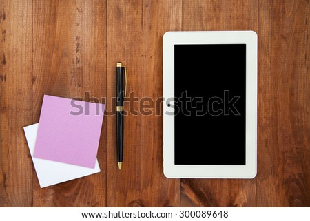 notebook isolated on a wooden background - stock photo