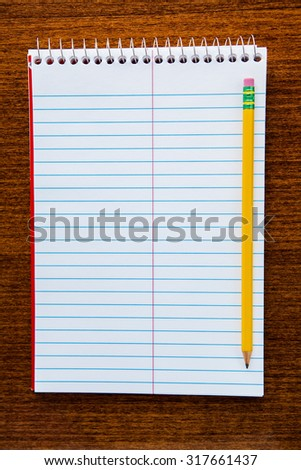 notebook isolated on a wooden background