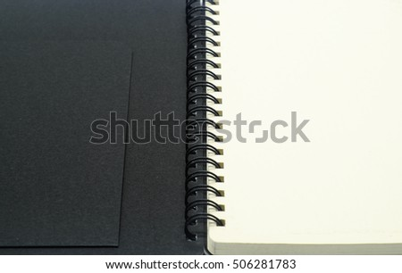 Notebook isolated on white background. Black notepad.