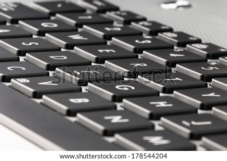 Notebook keyboard closeup background, selective focus