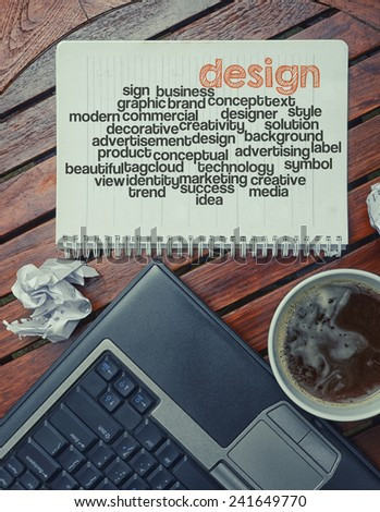 notebook lying on the table with the written words associated with the design , on the table are also laptop and cup of coffee, notes made in the form of the cloud of words  - stock photo