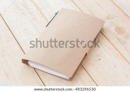Notebook, Notepaper, Post it notes on wood background, selective focus.