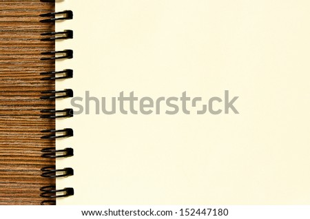 Notebook on a brown table