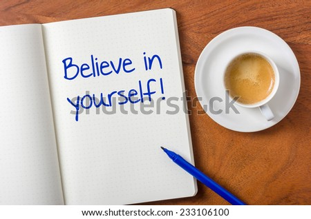 Notebook on a desk - Believe in yourself - stock photo