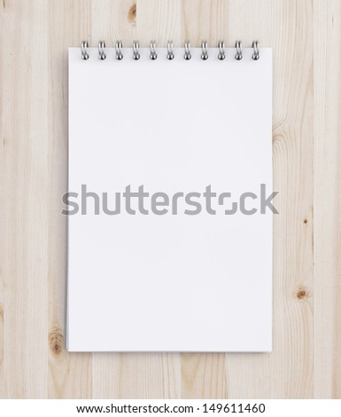 notebook on a wooden table - stock photo