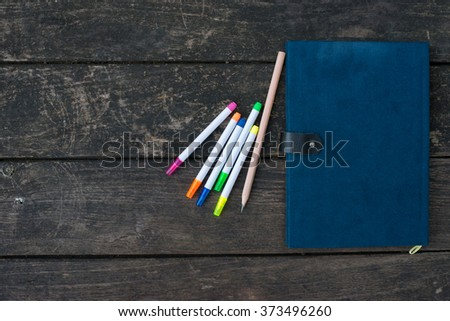 Notebook on desk and Pencil - stock photo