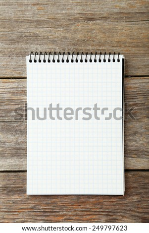 Notebook on grey wooden background
