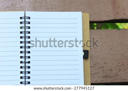 notebook on the brown bench during daytime