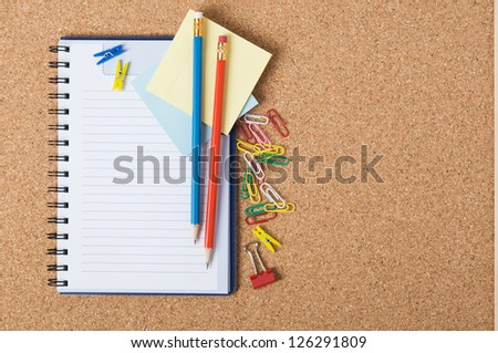 Notebook on the cork board with copy space