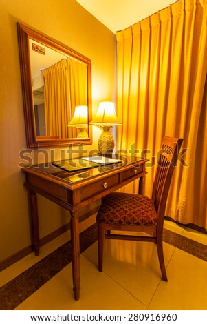 notebook on the table with lamp and chair in retro style
