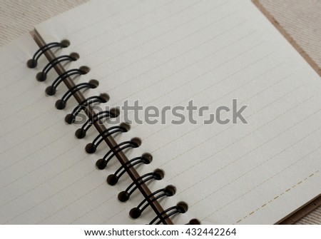 Notebook on the White cloth. copy space and selective focus