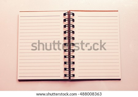 Notebook on white table