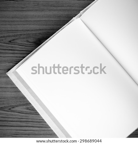 notebook on wood background black and white color tone style